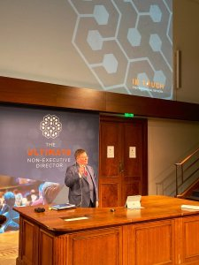 Photo of Stuart Bruce speaking in Faraday lecture hall at the Royal Institution