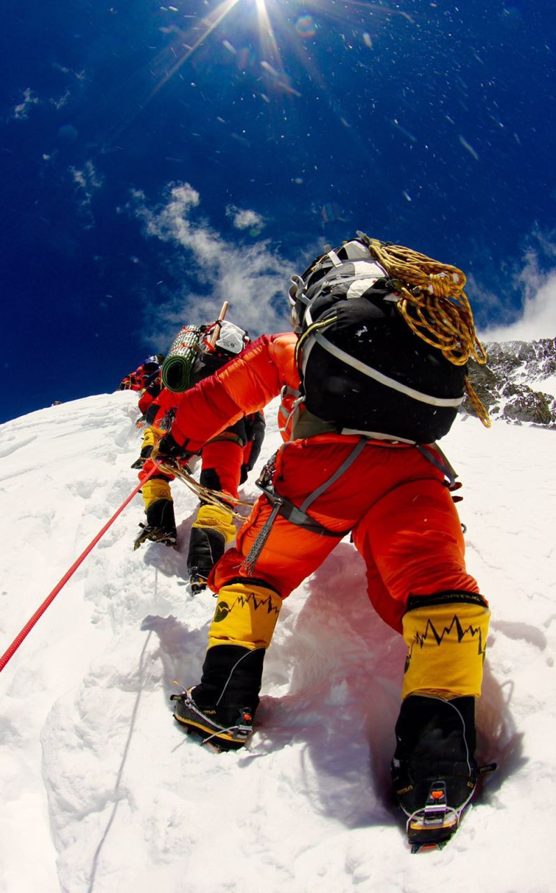 Climbers, Guides, Sherpas and Porters climbing from Camp 2 to Camp 3 up the steep, rocky and icy section called the Black Pyramid at about 23,000 ft ASL on K2 on July 12, 2016.