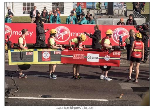 London Marathon Pictures - Fire Crew in Fire Engine Costume being interviewed by BBC Gaby Logan