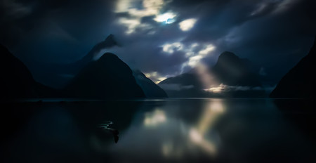 -Poems in the Moonlight in Milford Sound-I stayed out late… way after the sun went down. The moon was out in full force, so I was getting all sorts of interesting shots. For the briefest of moments, the moon shot through one of the clouds towards one of the mountains that holds a glacier. I grabbed it as quick as I could!