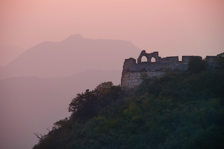Great Wall in Evening LightWhen I was at the Great Wall that evening, I kept hiking along the old wall as the sun set. I also had a zoom lens (28-300mm) with me, so I was able to get in tight on far away structures and shapes. Not too long after I took this shot, I walked along several lengths of the wall to get to these ruins. I stood there for a long time listening to music and taking photos.- Trey RatcliffRead more (and see a new video) here at the Stuck in Customs blog.