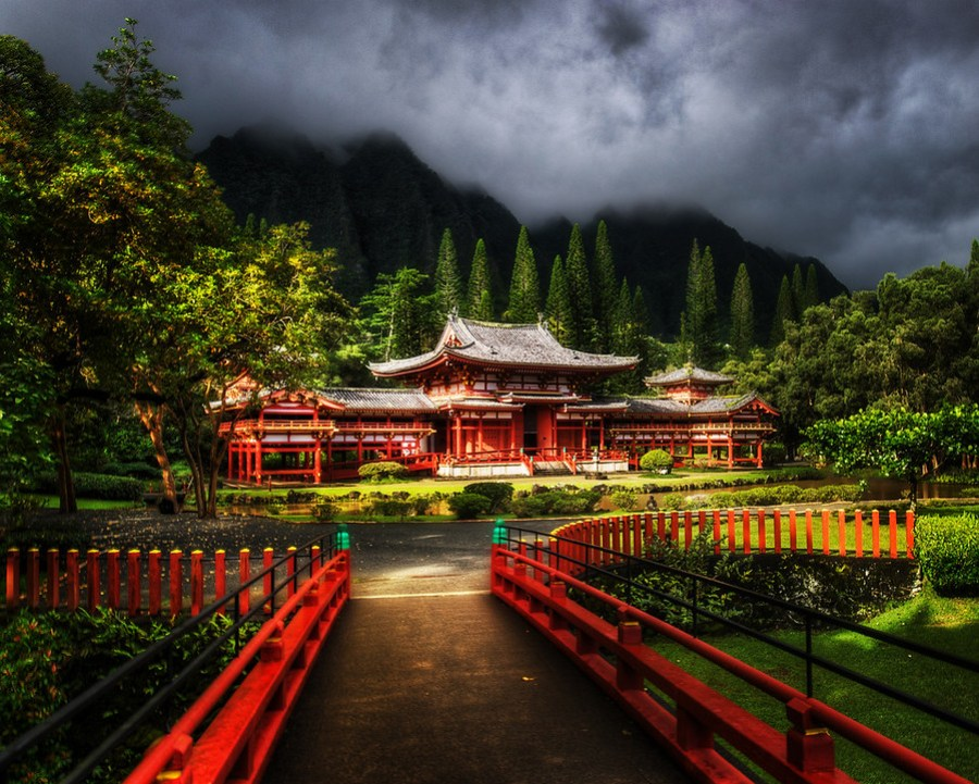 Temple in the Jungle Highlands - Byodo-In I would never have guessed that something as ornate and unique as this would be buried up in the deep jungled highlands of Oahu!It is a popular destination, and I guess people in Oahu know about it, but I had never heard of such a place.  This is the Byodo-In Temple, and I happened to arrive right when the sun came out.  This is a nice time because the morning fog and storms had left many layers of clouds and mist in the background, which gave everything a very unusual feel…- Trey RatcliffClick here to read the rest of this post at the Stuck in Customs blog.