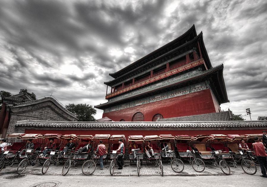 Rickshaws at the Drum Tower I've visited Gǔlóu many times and never taken a photo.  I just couldn't figure one out.And then, this most recent trip, I walked around the tower several times until I finally got an idea.This is the giant drum tower built about a thousand years ago by Kublai Khan.  An enormous drum rests in front, and it was beat rhythmically to announce meetings. The temple sits in the Inner City to the north of Di'anmen Street.- Trey RatcliffRead more, including a preview of an exciting announcement, here at the Stuck in Customs blog.