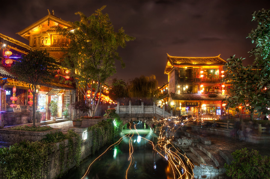 The Ancient Town of LijiangThis was a very long exposure -- about five minutes or so. I did this so I could help make most of the people disappear from the scene. It also had a nice side-effect down in the river. People would light candles and float them downstream, and the path they followed came out as little golden streaks.- Trey RatcliffRead the rest of this entry and some info on tonight's huge YouTube Live hangout here at the Stuck in Customs blog.