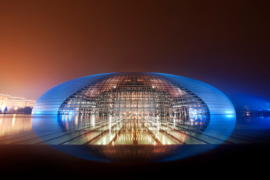 The Chinese Mothership Look at this magical place in Beijing... it's on the edge of belief.I could hardly fathom the nature of this place.  I expected the lights to appear on the grid with melodic tones a mystical, alien language, like in Close Encounters.  But none of that happened...  So I just stood there for a long time, thinking about how incredible this place was... and took my time, setting up my system for a fitting photograph.Remember when we were kids, and we never finished our food, even under the threat of starving children in China?  Now, I say to my kids, you better eat your food, or else Chinese children will grow up and create an economic powerhouse.  Well too late for that!This is the amazing National Centre for the Performing Arts, or as I like to say, the 国家大剧院 -- I find that rolls of the tongue a bit easier.- Trey RatcliffClick here to read the rest of this post at the Stuck in Customs blog.