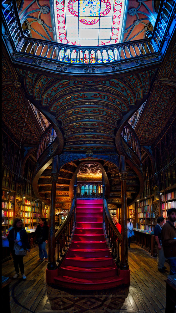This is two stacked photos of this Harry Potter like bookstore in Porto.