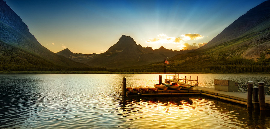 Sunset at Glacier National ParkI'm having a nice weekend processing photos.  I just completed this one a few hours ago, and it brought back good memories of Glacier National Park.  I don't think I ever really got warm there.  Even in the room there was a steady chill.  This is a strange memory of that place...  I normally don't mind the cold as there are a few occasions to warm up and reset my system.- Trey RatcliffRead more here at the Stuck in Customs blog.