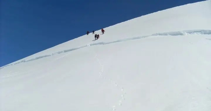 Group of people coming down the Hrútfjallstindar Peaks in the Vatnajokull glacier
