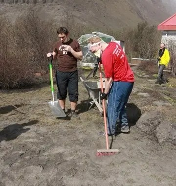 Cleaning the ash from Eyjafjallajokull eruption with brooms and shovels