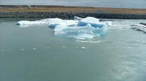 Icebergs drift down the small river that runs from the lagoon to the Atlantic ocean.