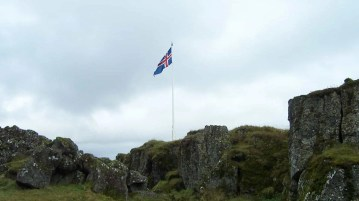 The Icleandic flag flies over Lögberg (The Law Stone) where it is believed the old parliament was held.