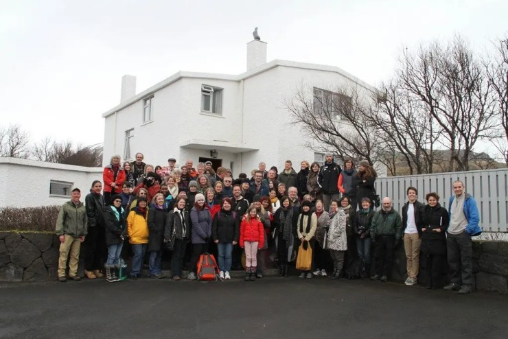 Iceland Writers Retreat delegates, a group of marvellous storytellers, clustered in front of the home of Halldór Laxness. (Photo credit: Kent Bjornsson)