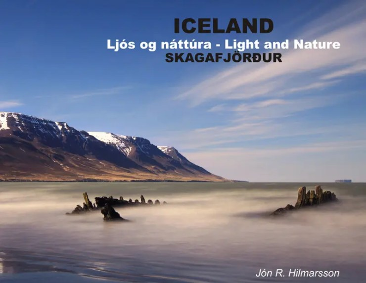 "Front cover of the first book ""Light and Nature of Skagafjordur"". The shipwreck Ernan at the beach close to the town Sauðárkrókur."