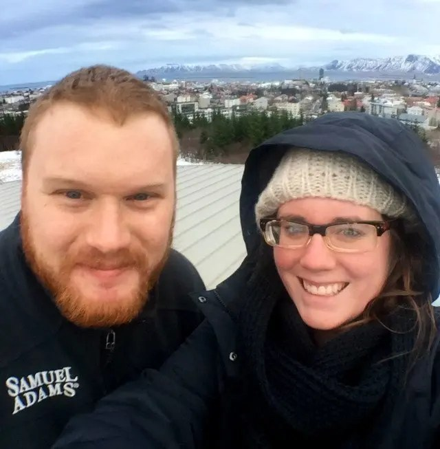 Eileen and her husband Christian buffeted by Icelandic gale at the observation deck of the Pearl in Reykjavik. But still smiling somehow.