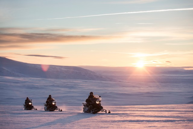 Snowmobiling on an Icelandic glacier.