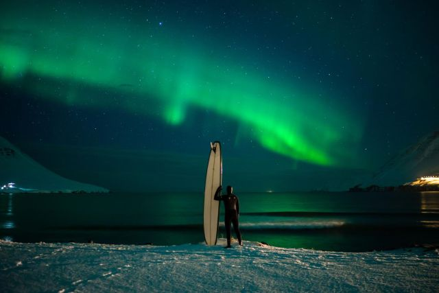 The northern lights show you the way to the surf. Photo by Chris Burkard.