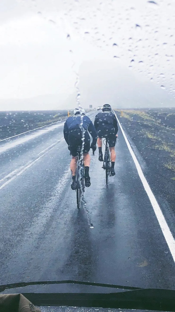 Cyclists in the rain in Iceland.