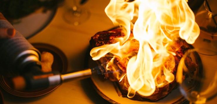 Cod head flames at the Vestman Island restaurant Slippurinn.