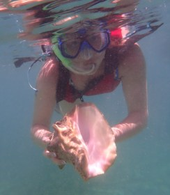 Anna holding a conch.