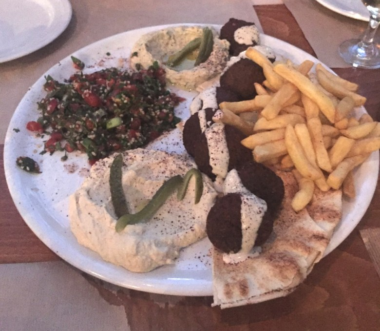 You have 72 hours in Athens to eat all the food possible. This is a plate full of falafel, hummus, fries, and pita.