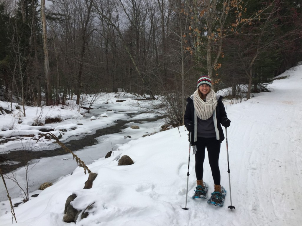 Snowshoeing beside the frozen river at Smugglers' Notch.