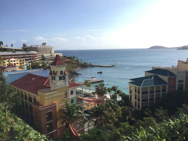 The ocean with colorful Marriott's Frenchman's Cove buildings in view in Charlotte Amalie, St. Thomas, USVI.