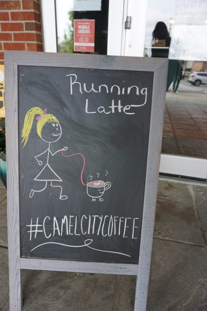"""chalkboard with girl and coffee on it saying """"Running Latte"""""""