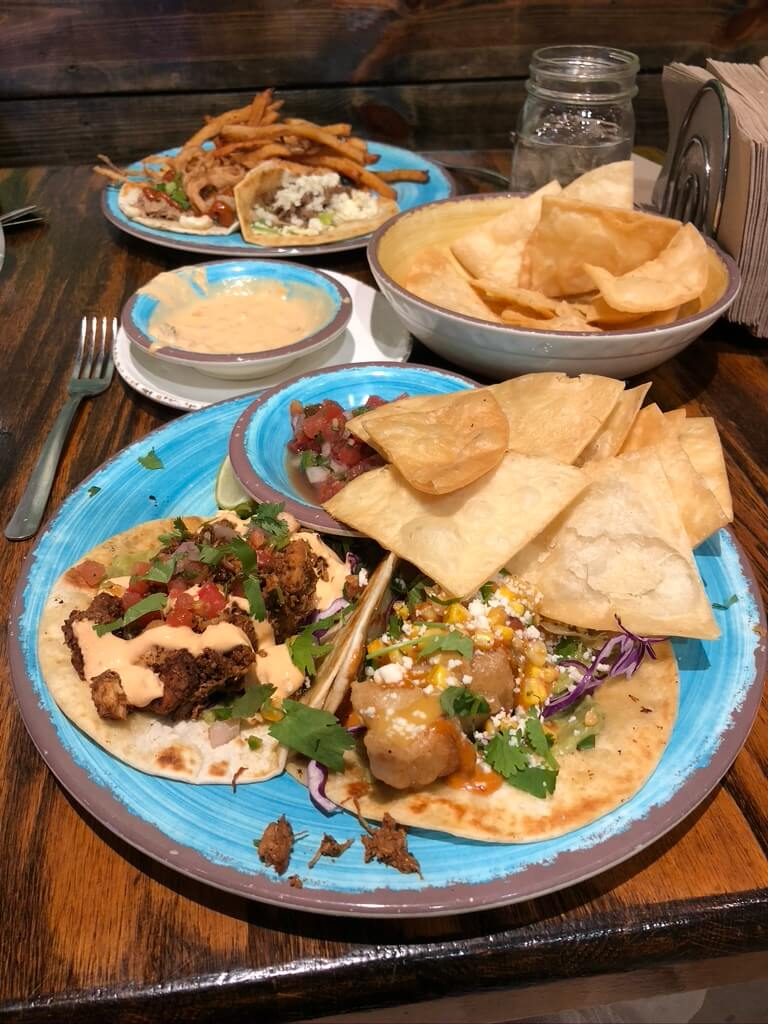 Two plates of tacos with chips & queso at one of the best downtown Winston-Salem restaurants