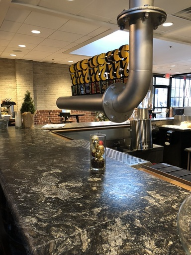 Beer taps above a bar