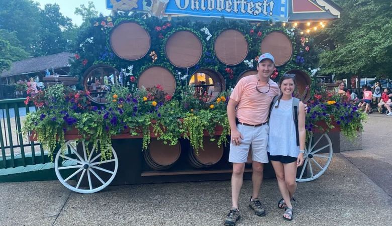 man and woman in front of Oktoberfest cart