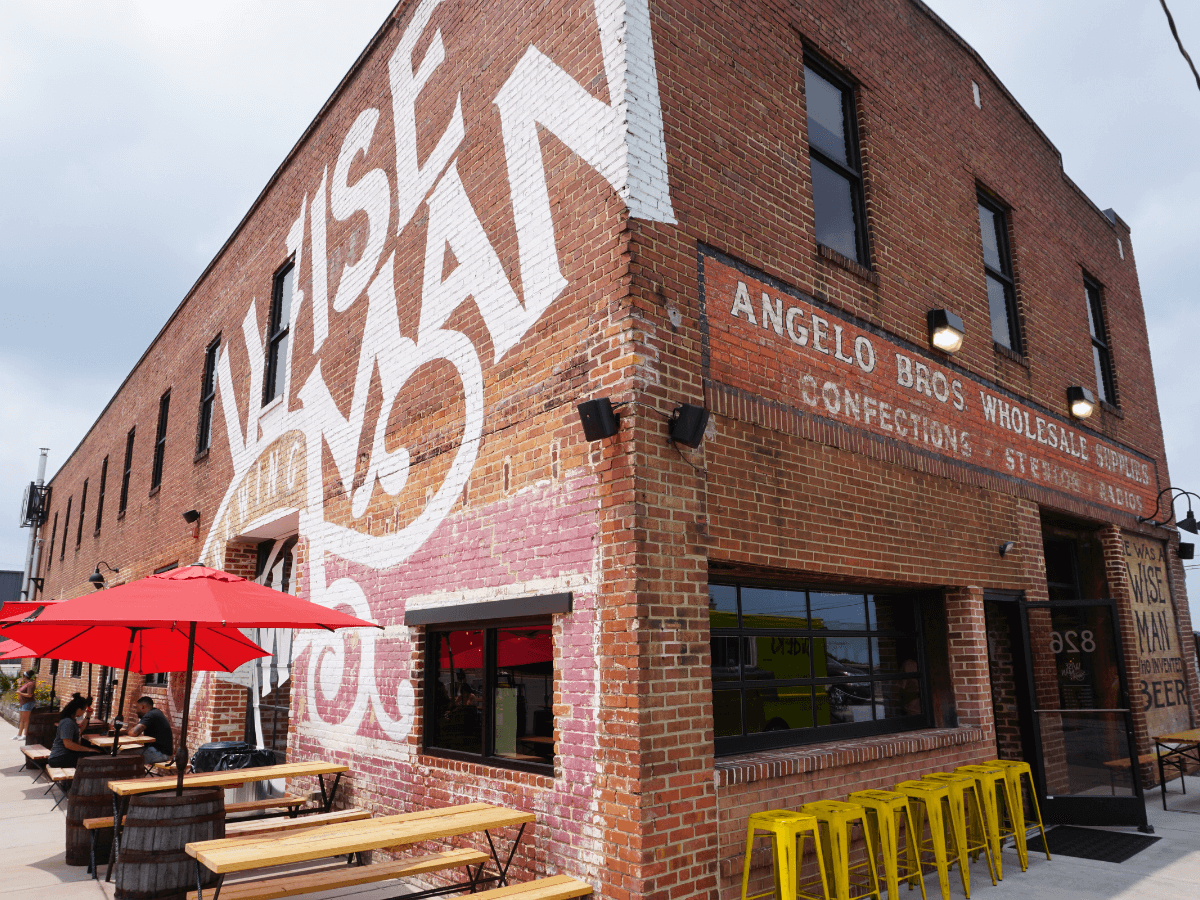 Brick building with Wise Man logo