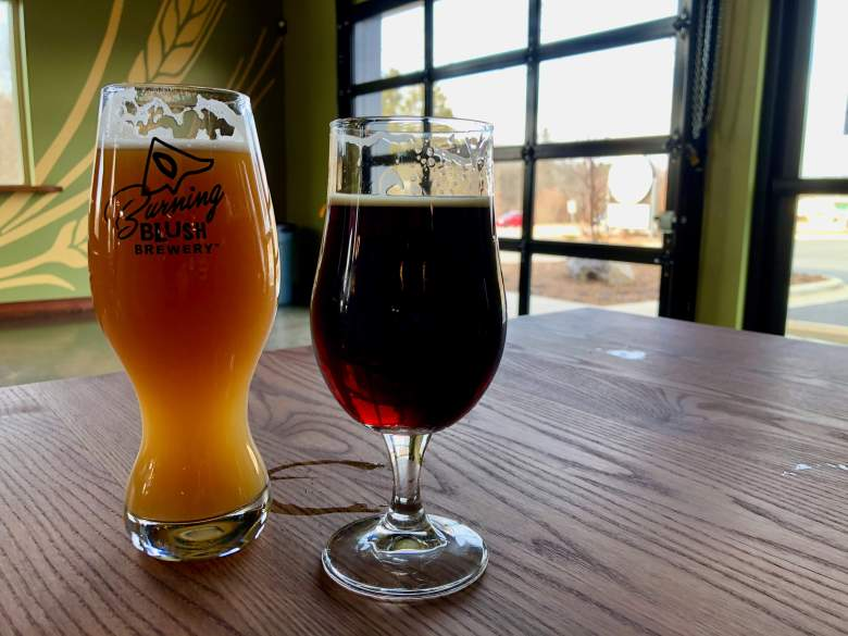 two beers on a table in small towns near Asheville