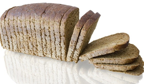 The cut loaf of bread with reflaction isolated on white