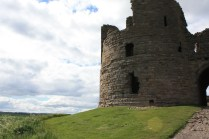 Dunstanburgh is made out of the same local stone as Bamburgh