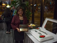 """The Honorable Maria Valdez with her award and """"everything"""" cake"""