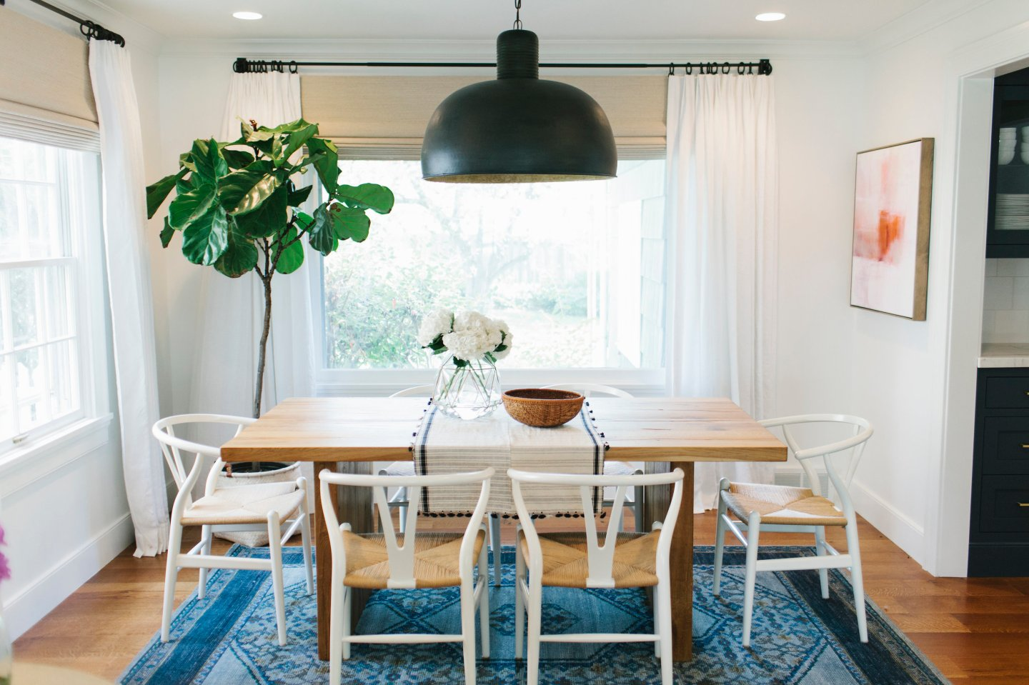 Dining room with fig tree by Studio McGee