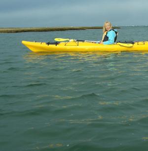 artist PJ Cook kayaking on Cape Cod.