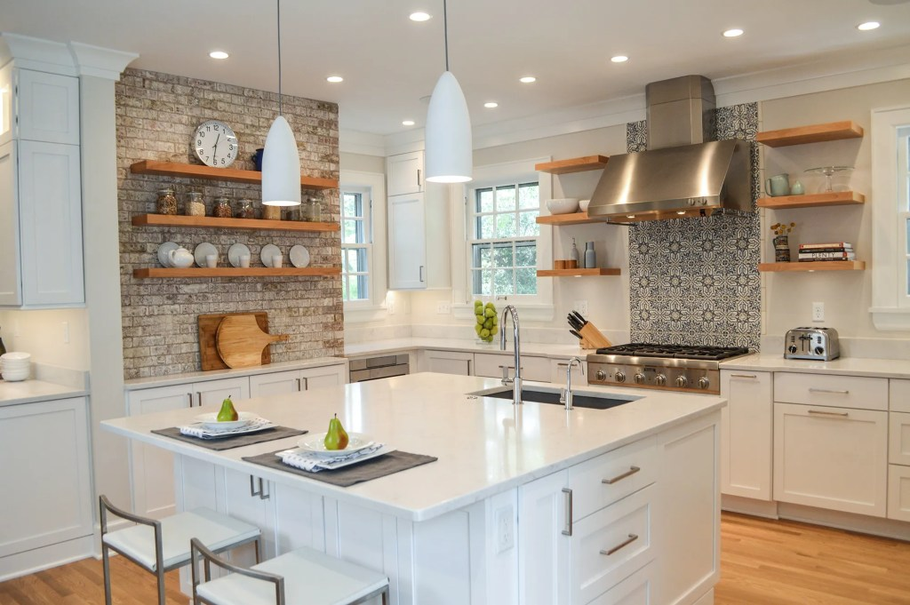 white kitchen remodel with brick wall open shelving blue accent tile