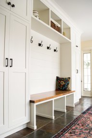 white cabinets storage and bench mudroom