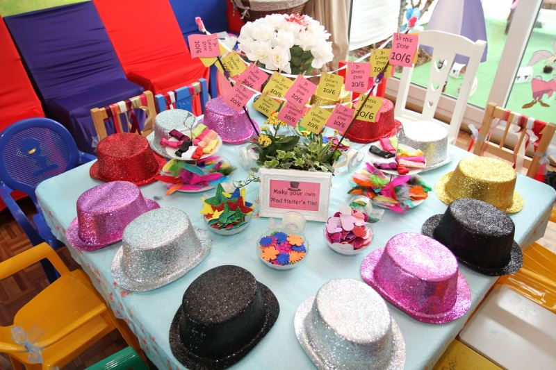 Children's craft table for making mad hatter's hats