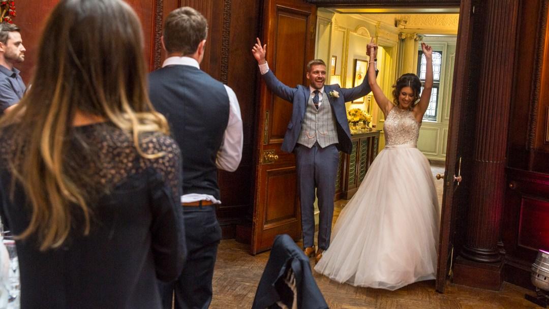 bride-and-groom-enter-wedding-breakfast