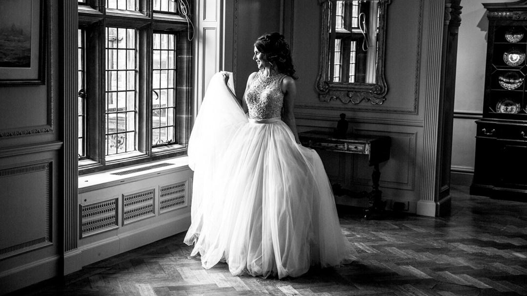 bride stood in window light at Thornton Manor