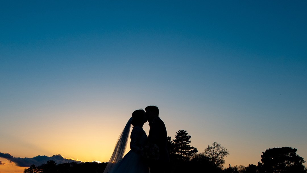 silhouette of bride and groom at Thornton Manor