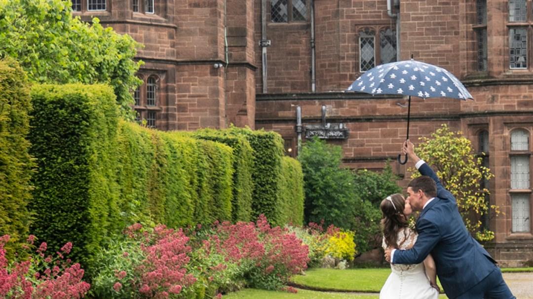 Bride & Groom in rain