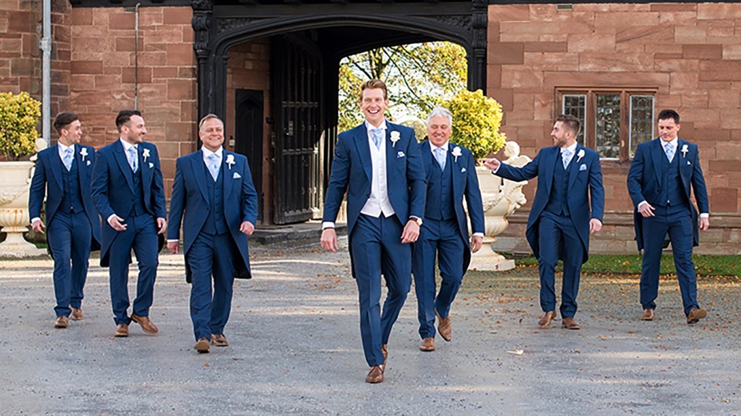 Groomsmen walk for photograph by Studio 900