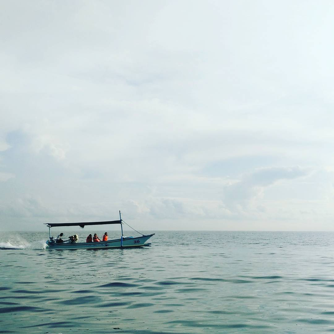 We're all in the same boat, heading somewhere fast.  #studioasobi #lovina #bali  #family #dolphins