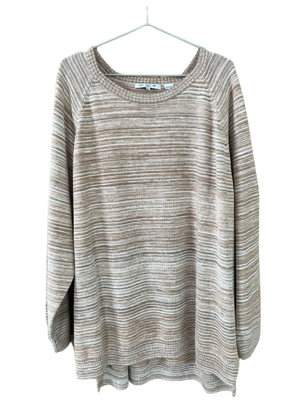 Oversized-style long-sleeved thrifted jersey in a dappled cream and light brown knit, against a plain white background.