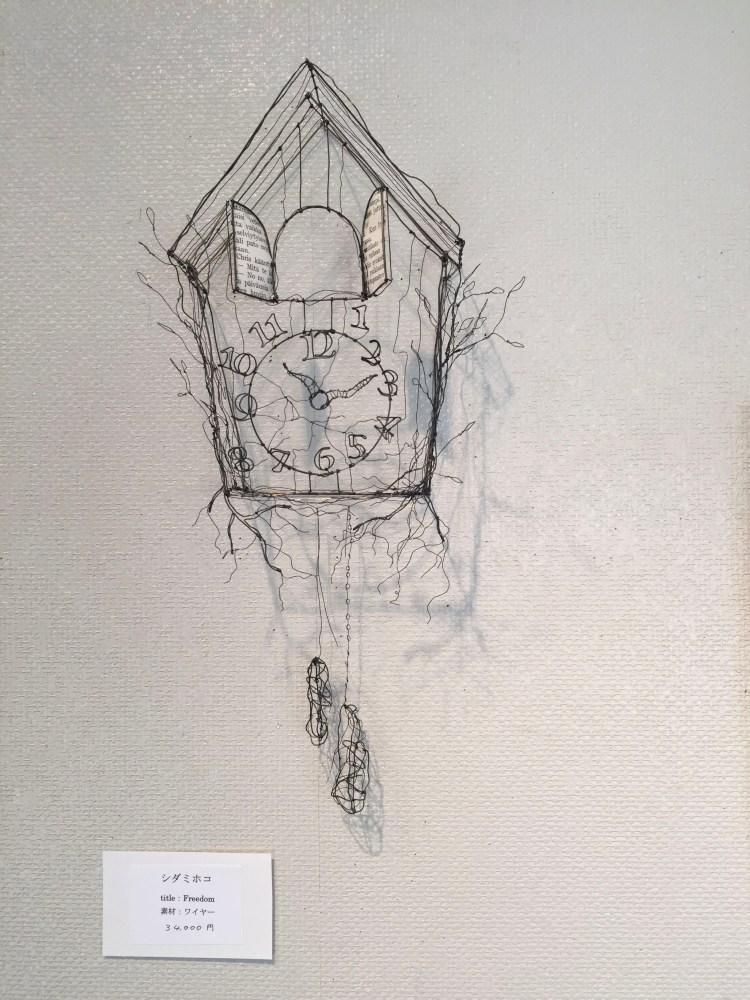 Traditional Swiss alarm cuckoo clock created from wire by Shida Mihoko