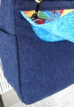 Secure Hidden Storage Under the Flap which is held securely in place by INVISIBLE sew-in magnetic snaps!