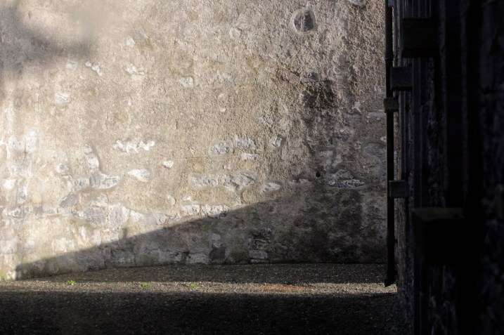Light makes its way into an interior passageway at Kilmainham Gaol.